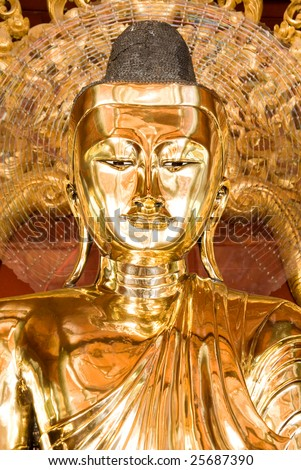 Golden Buddha statue at the Shwedagon pagoda, Yangon, Myanmar (Burma)