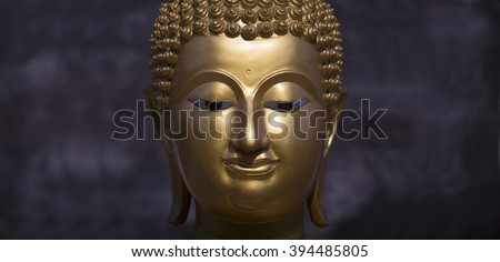 Golden Buddha statue close up - stock photo