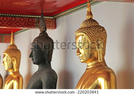Golden Buddha statue in a temple - stock photo