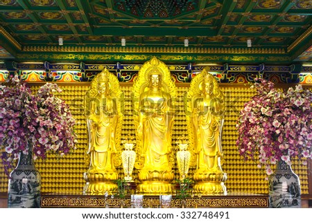 Golden buddha statue in Chinese temple in Thailand - stock photo