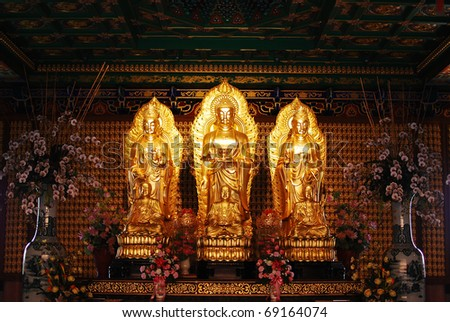 golden buddha statue in chinese temple in Thailand