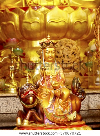 Golden buddha statue in Chinese temple, Mercy Temple enlightenment, Kanchanaburi - stock photo