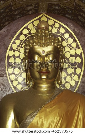golden buddha statue in post meditation. Buddha sits with hands in meditation position - stock photo