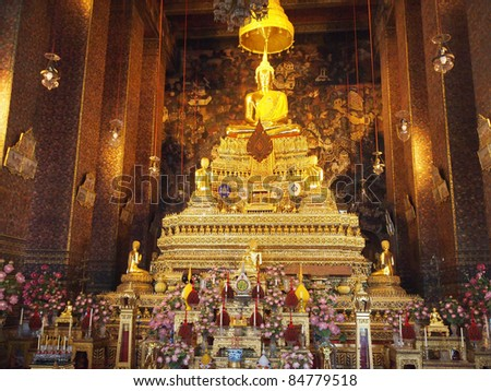 Golden Buddha statue in Thailand temple - stock photo