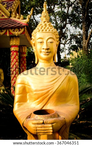 Golden buddha Statue in Vientiane, Laos. Generally in Laos, any kinds of decorated in Buddhist church, etc. they are public domain of Buddhism - stock photo