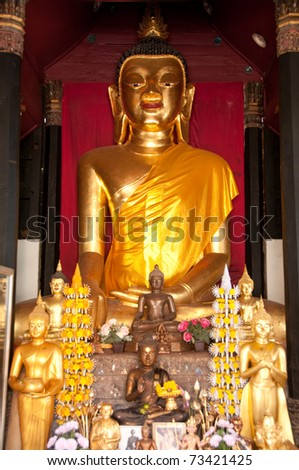 Golden Buddha statue inside a temple.