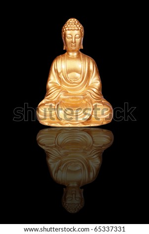 Golden Buddha statue isolated on black - stock photo