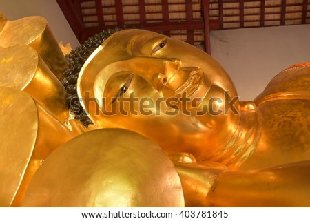 Golden Buddha statue, smiling faces.in chiang mai ,thailand.Golden smiling statue