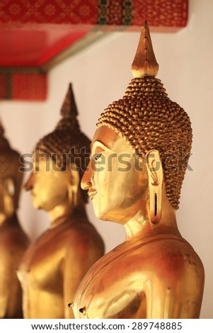 Golden Buddha statue. Wat Pho, Bangkok, Thailand - stock photo