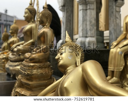 Golden buddha statues at the Wat Trai Mit Golden Buddha Temple in Bangkok Thailand