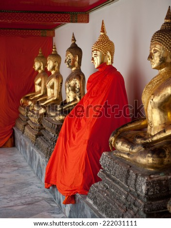 Golden Buddha statues in a Buddhist temple - stock photo