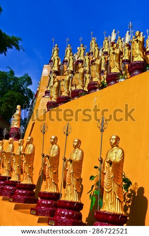 Golden Buddha statues in a temple in Kaohsiung, Taiwan - stock photo