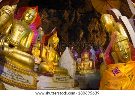 Golden Buddha statues in Pindaya Cave located next to the town of Pindaya, Shan State, Burma (Myanmar) are a Buddhist pilgrimage site and a tourist attraction. - stock photo