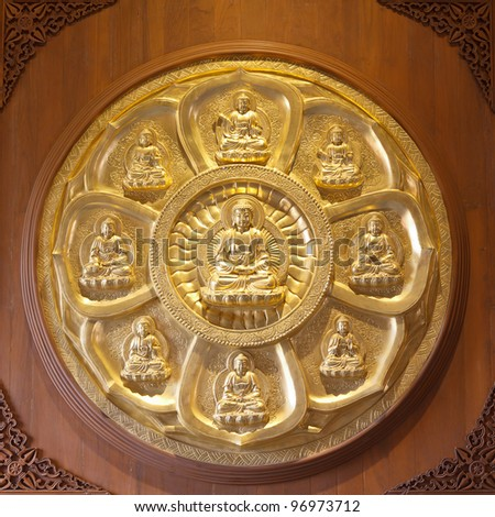 golden buddhas arranged in a circle