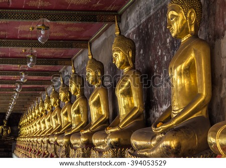 Golden buddhas in Wat Suthat, Bangkok, Thailand - stock photo