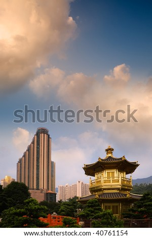 Golden Buddhism tower with modern tall buildings in the city. - stock photo