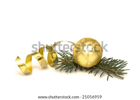 Golden  bulbs and spruce twigs on a white - stock photo