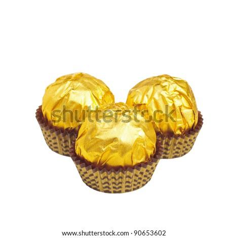 Golden candys isolated on white background - stock photo