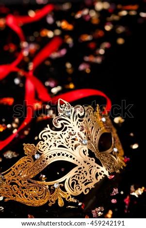 Golden carnival mask on black background.  - stock photo