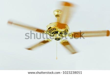 Golden Ceiling Fan, Ceiling Fan Are Rotating, Ceiling Fan Are Rolling,  Electronics In