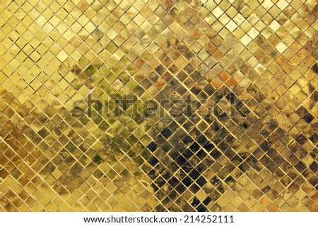 Golden ceramic tile in The Grand Palace & Wat Phra Kaew (The Emerald Buddha Temple), Bangkok, Thailand.  - stock photo