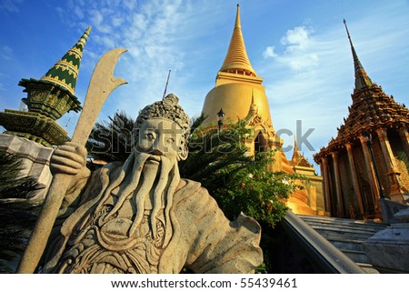 Golden Chedi at Wat Phra Kaew in Thailand - stock photo