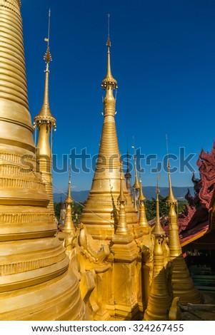 Golden chedis at the Shwe Inn Tain Pagoda - stock photo