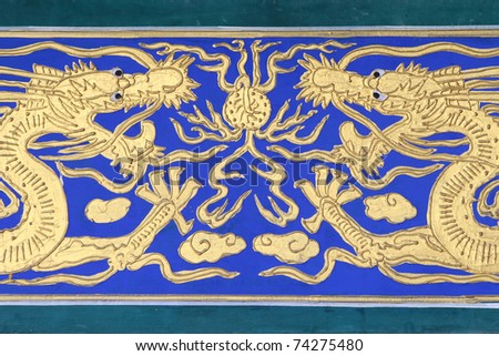 Golden Chinese Dragon on Blue Background - stock photo