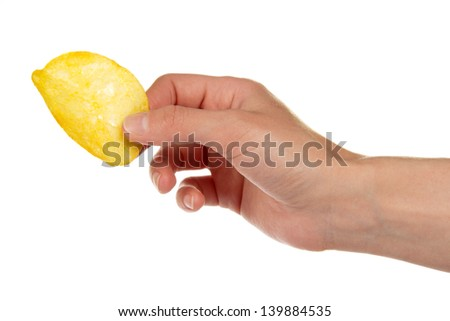 Golden chips in a hand, isolated on white - stock photo