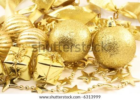 Golden christmas assortment. Balls, gift boxes, stars - stock photo