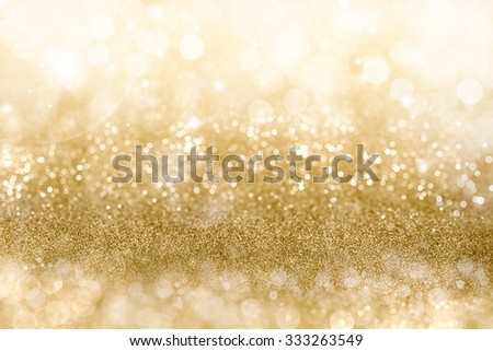 Golden Christmas background with graduated bands of different sparkling and twinkling bokeh from party lights and glitter, full frame copyspace for your seasonal greeting - stock photo