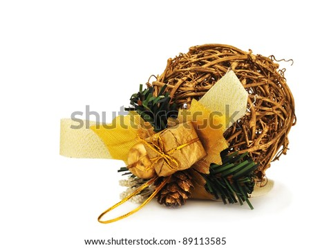 Golden Christmas ball made of willow on the white