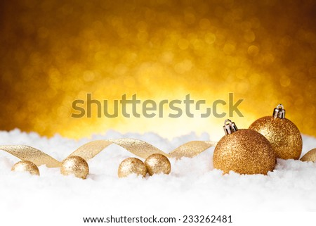 Golden christmas ball on glitter background. studio shot