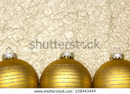 Golden Christmas ball on gold paper background - stock photo