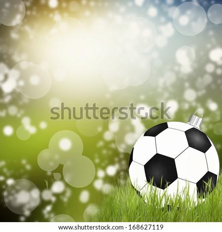 Golden christmas ball on the grass  - stock photo