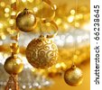 golden christmas balls on bokeh background - stock photo