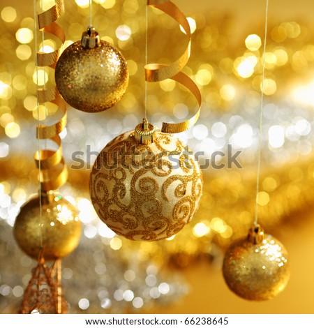 golden christmas balls on bokeh background - stock photo