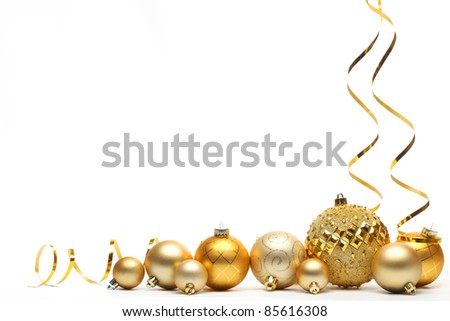 Golden Christmas balls with ribbons isolated on white. - stock photo