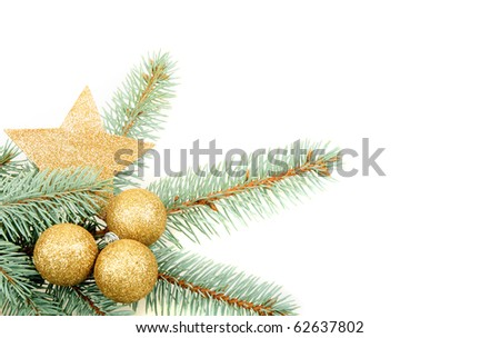 golden christmas balls with star on green branch