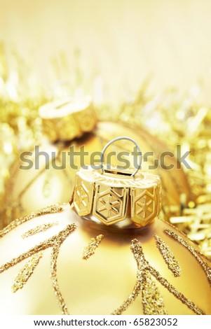 Golden Christmas baubles - stock photo