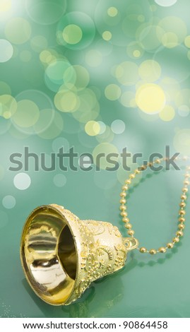 golden christmas bell on green background
