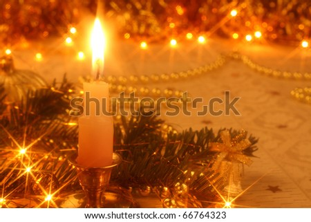 Golden Christmas card with candlelight, ornaments and Christmas lights