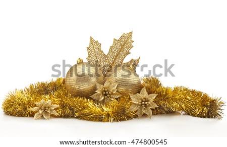 Golden Christmas center arrangement against white background. Christmas balls, golden garland and leaf, flowers and spangles.