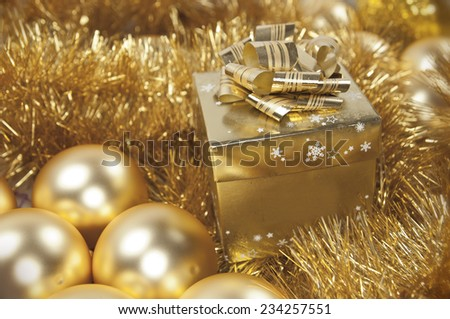 Golden christmas gift and glass baubles
