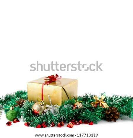 Golden christmas gift box with christmas balls over white background - stock photo