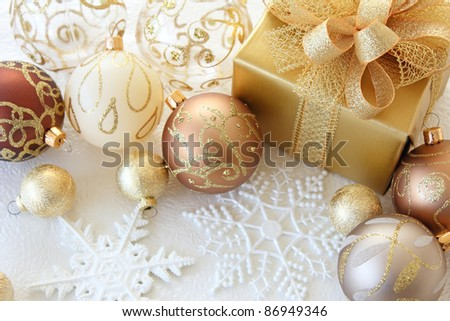 Golden christmas gift with christmas decoration on white background. flat lay form over head view.