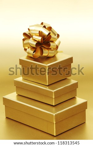 golden christmas gifts on gold background - stock photo