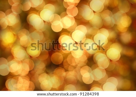 Golden Christmas lights at night. Beautiful blurred background. - stock photo