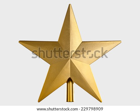 Golden Christmas Star isolated on Grey Background. Top View Close-Up - stock photo