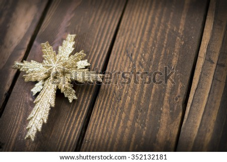 golden Christmas Star on wood texture background on angle